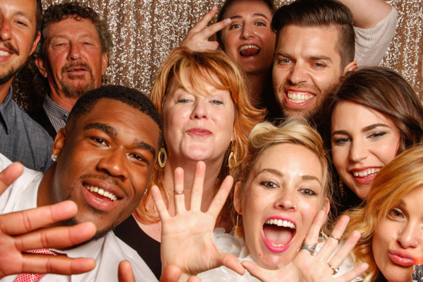 People posing in a photo booth